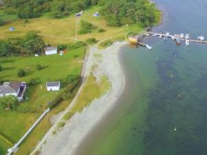 MERDØ: Gravene På Merdø øverst I Bildet Er En God Teltplass. Fin Strand Med Klart, Rent Vann. Foto: Arendal Kommune