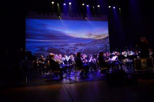 BILDESHOW: Under åpningsnummeret Til Arendal Byorkester Ble Det Vist Bilder Av Arendals Natur Tatt Av Jarle Kvam.